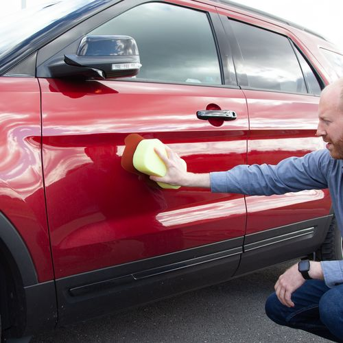 Clean and wet your car before placing the magnet on the surface